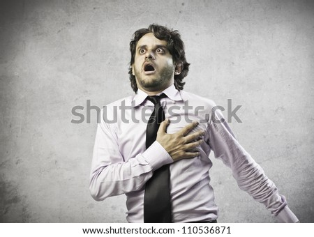 Businessman having a heart attack - stock photo