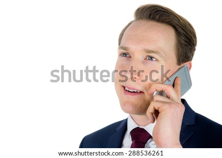 Businessman having a phone call on white background