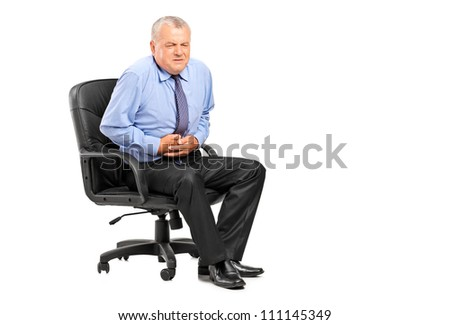 Businessman having a stomach ache isolated on white background - stock photo