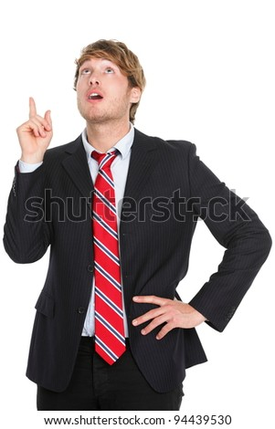 Businessman having an idea - eureka. Thinking young business man pointing up in suit isolated on white background. - stock photo