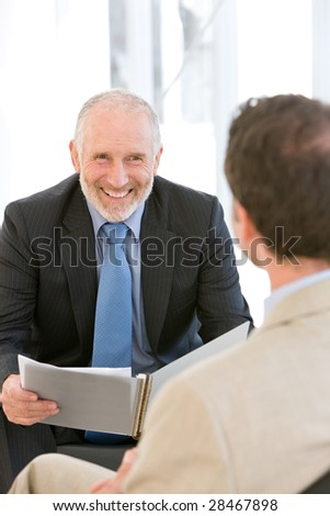 Businessman having discussion - stock photo