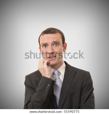 businessman having expression of stress in studio - stock photo