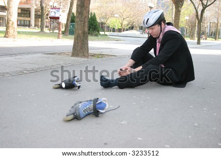 Businessman having foot pain from rollerblading - stock photo