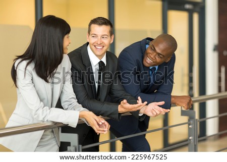 businessman having fun conversation with colleagues during break - stock photo