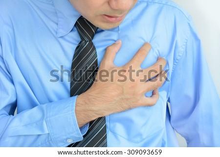 Businessman having heart disease - stock photo