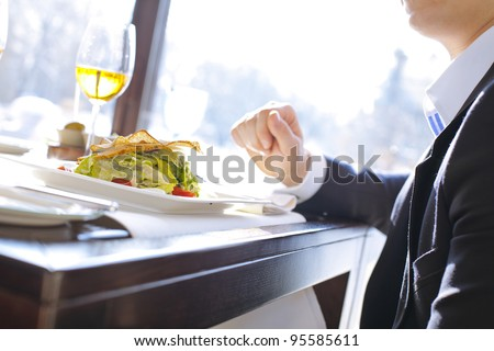 businessman having lunch in a restaurant - stock photo