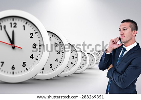 Businessman having phone call against grey background
