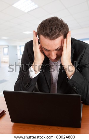 Businessman having problems with computer
