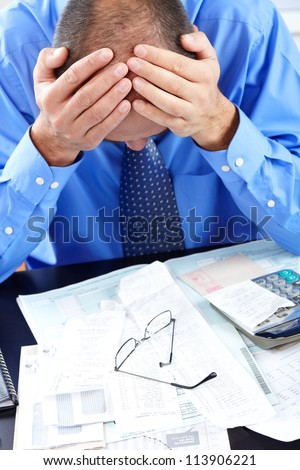 Businessman having stress in the office. Crisis - stock photo