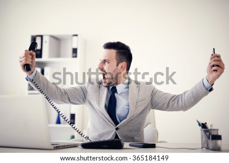 Businessman having stress in the office.Having a headache after working really hard.  - stock photo