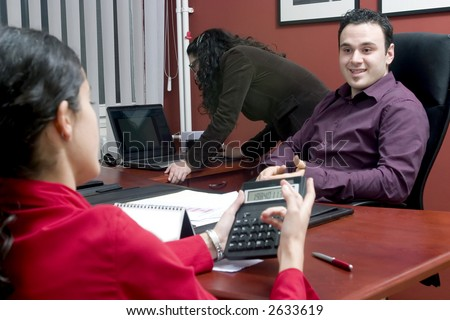 Businessman having talk with young women- discussion