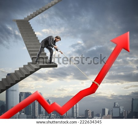 Businessman helps with success his company statistic - stock photo