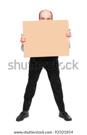 Businessman hiden under empty sign board. - stock photo