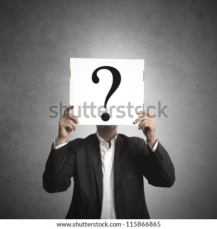 Businessman hiding behind his doubts - stock photo