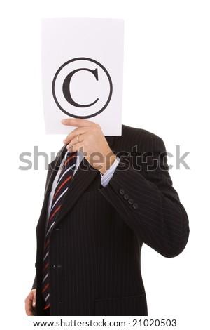 businessman hiding behind the copyright symbol - stock photo