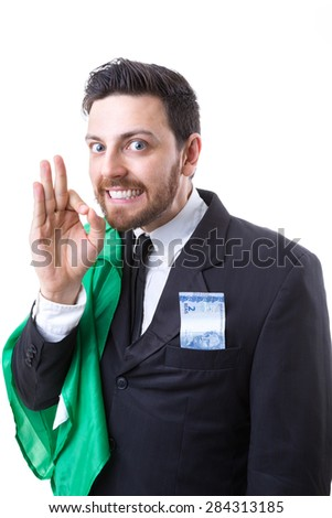 Businessman hiding Brazilian money and the flag of Brazil - stock photo