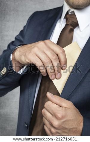 businessman hiding bribes - stock photo