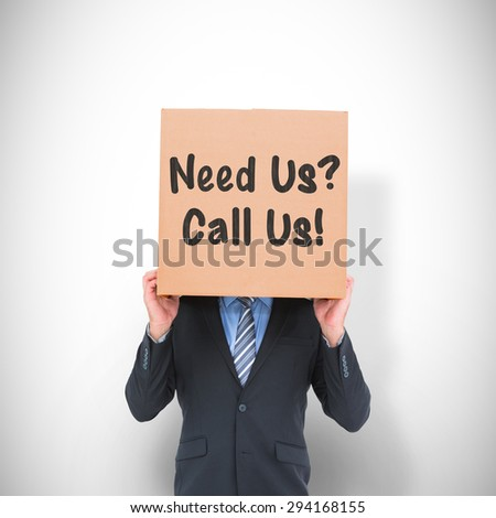Businessman hiding head with a box against white background with vignette - stock photo