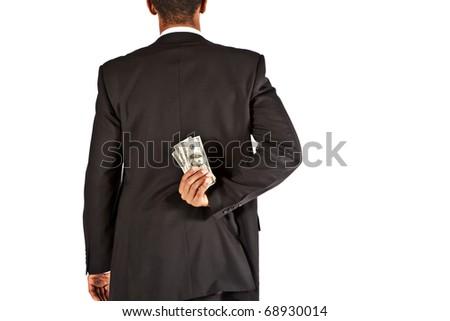 businessman hiding money behind his back - stock photo