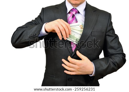 Businessman hiding money in pocket - stock photo