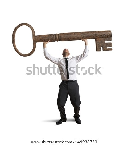 stock-photo-businessman-hold-a-key-to-su