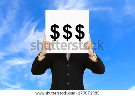 Businessman hold board with money sign on blue sky background - stock photo