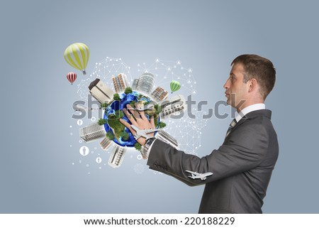Businessman hold Earth with buildings. Elements of this image are furnished by NASA