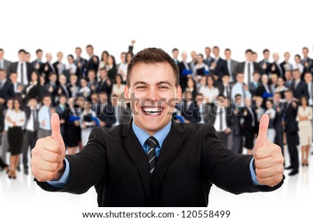 businessman hold hand with thumb up gesture, business man excited happy smile over big group of businesspeople background - stock photo