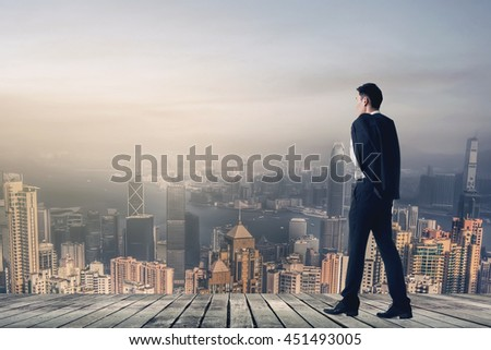 Businessman hold his coat after work and walk to somewhere.