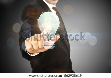 businessman hold mobile showing light bulb web engineering , Business idea concept