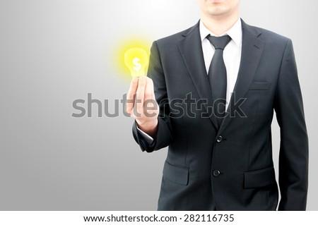 Businessman hold money dollar sign in bulb on hand creative business idea concept - stock photo