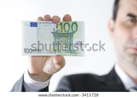 businessman hold money in hand - stock photo