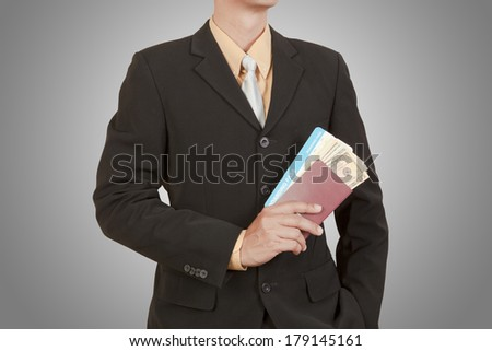 Businessman hold passport, boarding pass and dollar on blue sky background  - stock photo