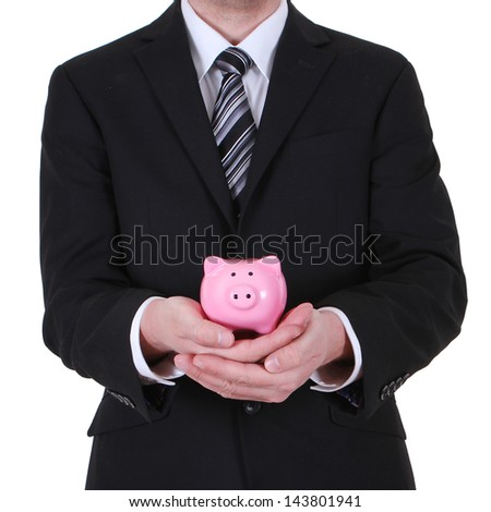 Businessman hold piggy bank isolated on white background