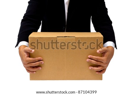 Businessman hold the cardboard box - stock photo