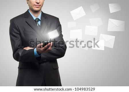 Businessman hold touch screen mobile phone and sends a virtual message