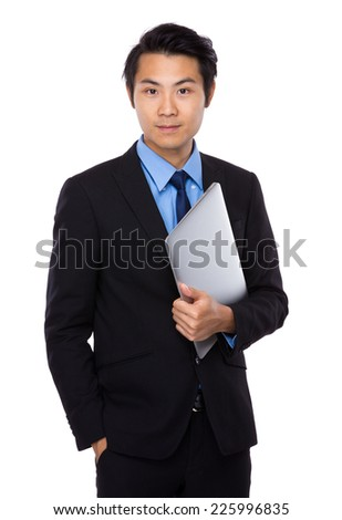 Businessman hold with laptop - stock photo