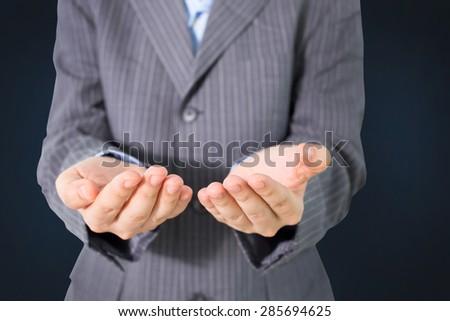 Businessman holding - stock photo