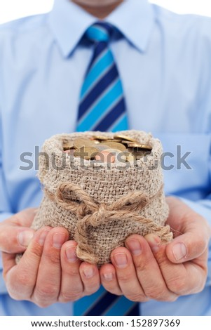 Businessman holding a bag of euro coins - community funding concept - stock photo