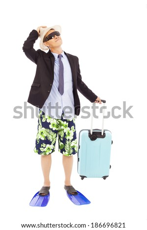 businessman holding a baggage and look up - stock photo