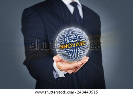 Businessman holding a ball formed by business related words - stock photo