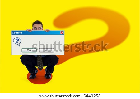 Businessman holding a big (empty) software confirmation dialog. He is standing on a big question mark background