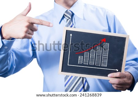 businessman holding a blackboard with writing growth graph of performance - stock photo