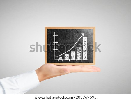 businessman holding a blank blackboard