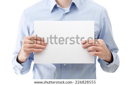 Businessman holding a blank paper. - stock photo