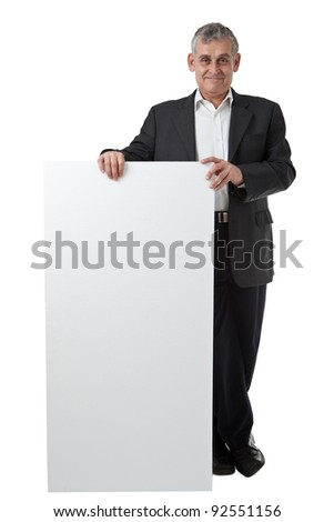 Businessman holding a blank sign in front of him - stock photo