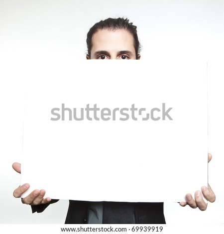 Businessman holding a blank sign in front oh his face - stock photo