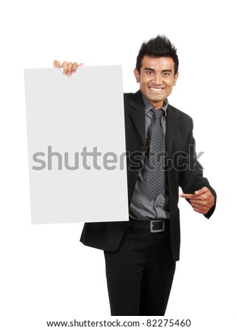 Businessman holding a blank sign, one finger pointing to the sign - stock photo