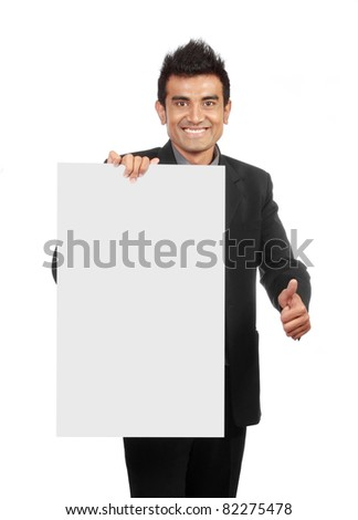 Businessman holding a blank sign, one hand showing thumb up sign - stock photo