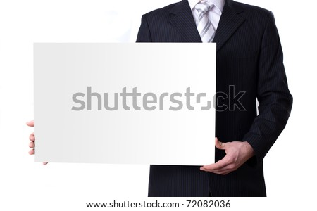 Businessman holding a blank white board - stock photo